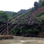 Vietnam dirt bike tours over a bamboo bridge