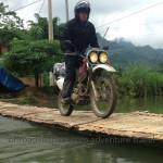 Vietnam dirt bike tours over a bamboo bridge